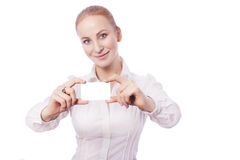 Blonde business woman manager worker smiles and shows a card. is Royalty Free Stock Photography