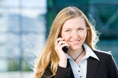 Blonde business woman on mobile phone Royalty Free Stock Photos