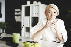 Blonde business woman in the office royalty free stock photo