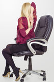 Blonde business woman stretching shoulders in her office Royalty Free Stock Images