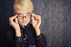 Blonde business woman in suit with eyeglasses Royalty Free Stock Image