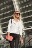 Blonde business woman in sunglasses stock images