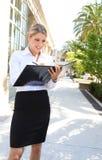 Blonde Business Woman Writing Stock Photo