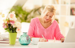 Blonde business woman writing  Royalty Free Stock Image