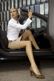 Blonde businesswoman in a car Stock Photo