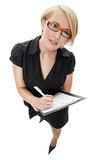 Blonde businesswoman with clipboard and document Stock Photography