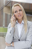 Blonde businesswoman communicating on cell phone Stock Photography
