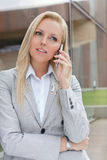 Blonde businesswoman communicating on cell phone Stock Photos