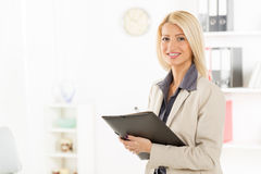 Blonde Businesswoman With Folder Stock Photography