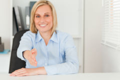 Blonde businesswoman giving hand Stock Photography