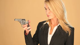 Blonde businesswoman with a gun Royalty Free Stock Photos