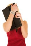 Blonde businesswoman hiding. Young blonde adult businesswoman, hiding behind leather document folder. Isolated on white Royalty Free Stock Photo