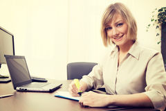 Blonde businesswoman highlighting chart. Business concept. Toned image Stock Images