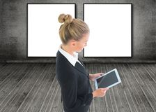 Blonde businesswoman holding tablet Stock Images