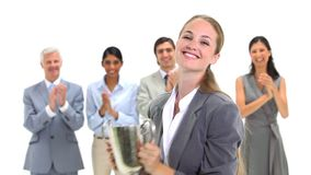 Blonde businesswoman holding a trophy Royalty Free Stock Image