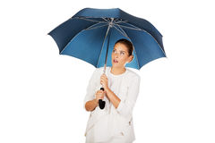Blonde businesswoman holding an umbrella Royalty Free Stock Photography