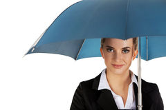 Blonde businesswoman holding an umbrella Royalty Free Stock Images