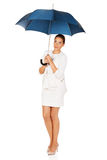 Blonde businesswoman holding an umbrella Stock Photography