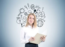 Blonde businesswoman, internet search Stock Photography