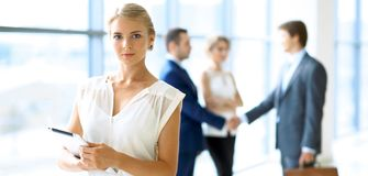 Blonde businesswoman looking at camera royalty free stock photos