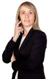 Blonde businesswoman with a mobile Royalty Free Stock Photo