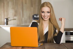 Blonde businesswoman in office Stock Photography