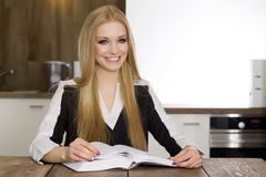 Blonde businesswoman in office Royalty Free Stock Photography