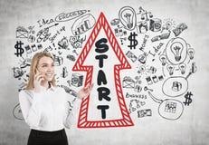Blonde businesswoman on a phone, startup arrow Stock Photos