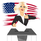 Blonde businesswoman putting ballot in vote box Royalty Free Stock Photos