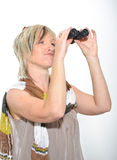 Blonde businesswoman with scarf looking with binoculars Stock Photography