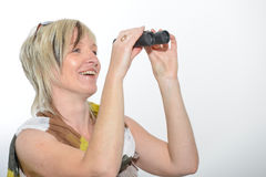 Blonde businesswoman with scarf looking with binoculars Stock Photos