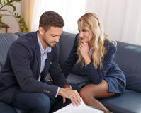 Blonde businesswoman seducing rich young businessman. In office Stock Photography