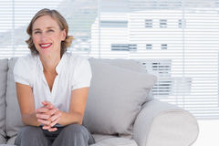 Blonde businesswoman sitting on couch Stock Photos