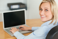 Blonde businesswoman smiling into camera Royalty Free Stock Photography
