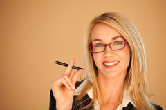 Blonde businesswoman smoking Royalty Free Stock Photos