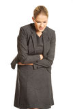 Blonde businesswoman with strong stomachache Royalty Free Stock Photo