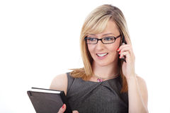 Blonde businesswoman talks over mobile phone Stock Photos