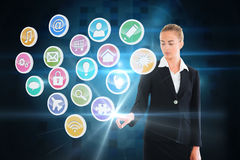 Blonde businesswoman touching app icon interface Stock Photography