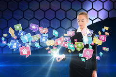 Blonde businesswoman touching app icon interface Royalty Free Stock Photos