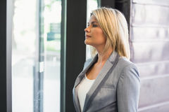 Blonde businesswoman waiting for someone Royalty Free Stock Photo
