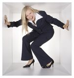 Blonde businesswoman in the white cube Stock Images