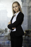 Blonde businesswoman on the window. Business concept - portrait of a beauty young adult attractive pretty blonde businesswoman in office Stock Photo