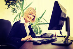Blonde businesswoman working on computer at the office Royalty Free Stock Photography