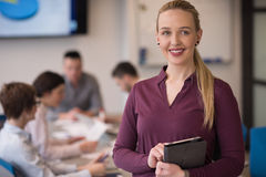 Blonde businesswoman working on tablet at office Royalty Free Stock Photo