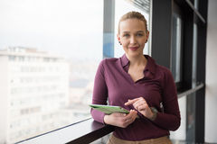 Blonde businesswoman working on tablet at office Stock Photos