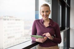 Blonde businesswoman working on tablet at office Royalty Free Stock Photography