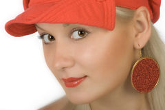 Blonde in cap. Happy blonde in red cap Royalty Free Stock Images