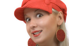 Blonde in cap. Happy blonde in red cap Stock Photo