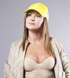 Blonde in a cap Royalty Free Stock Image