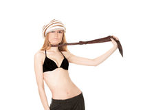 Blonde in cap stripping Royalty Free Stock Images